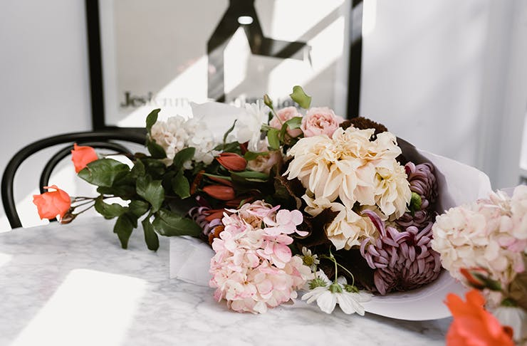 Mother's Day bouquet delicately placed on table.