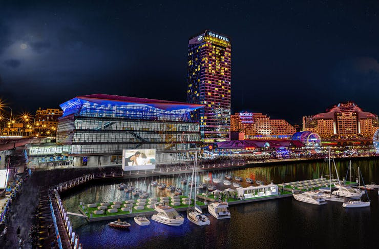 A render image of Darling Harbour in Sydney, complete with a floating cinema.