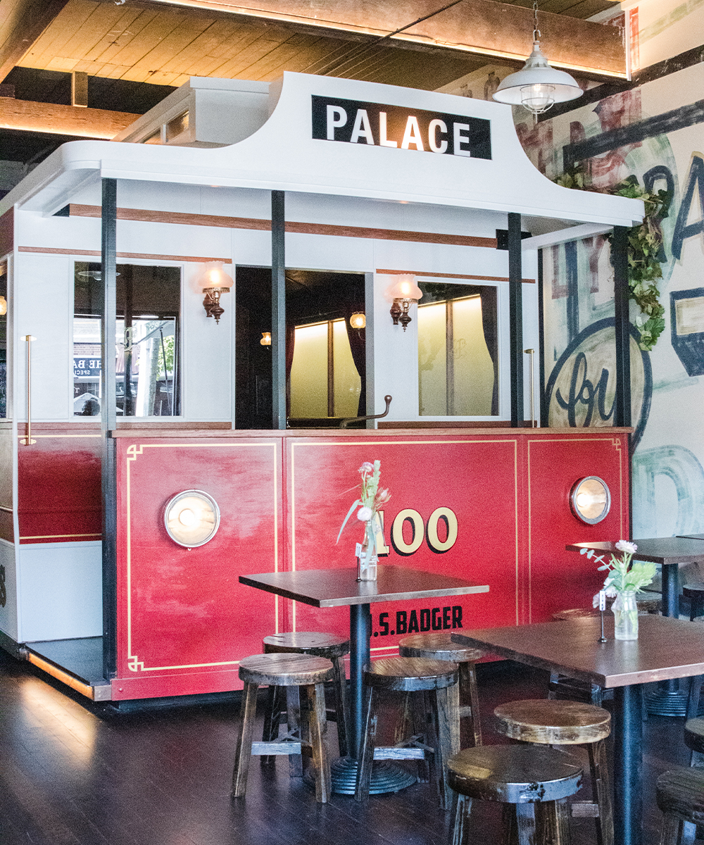a large red tram inside a restaurant