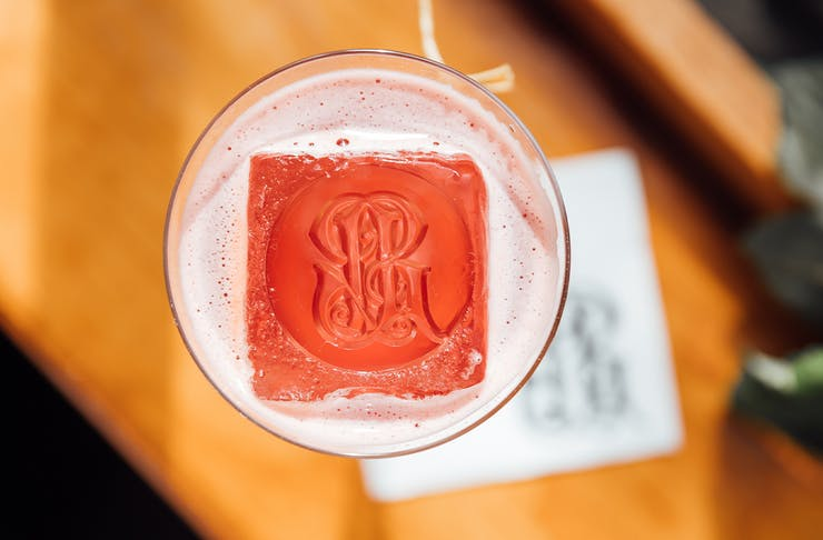 a cocktail with a patterned ice cube