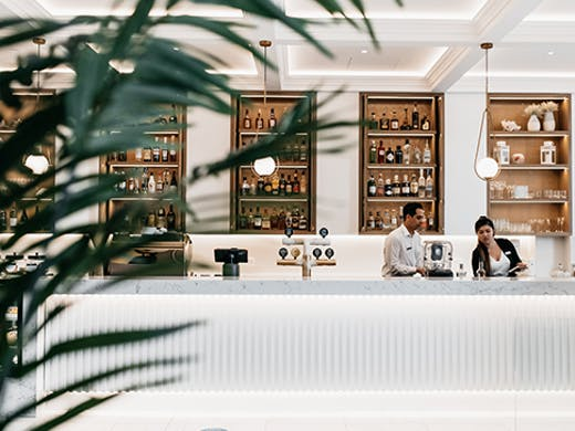The sleek, white interior and gleaming bar of Ms Margot in Surfers Paradise.