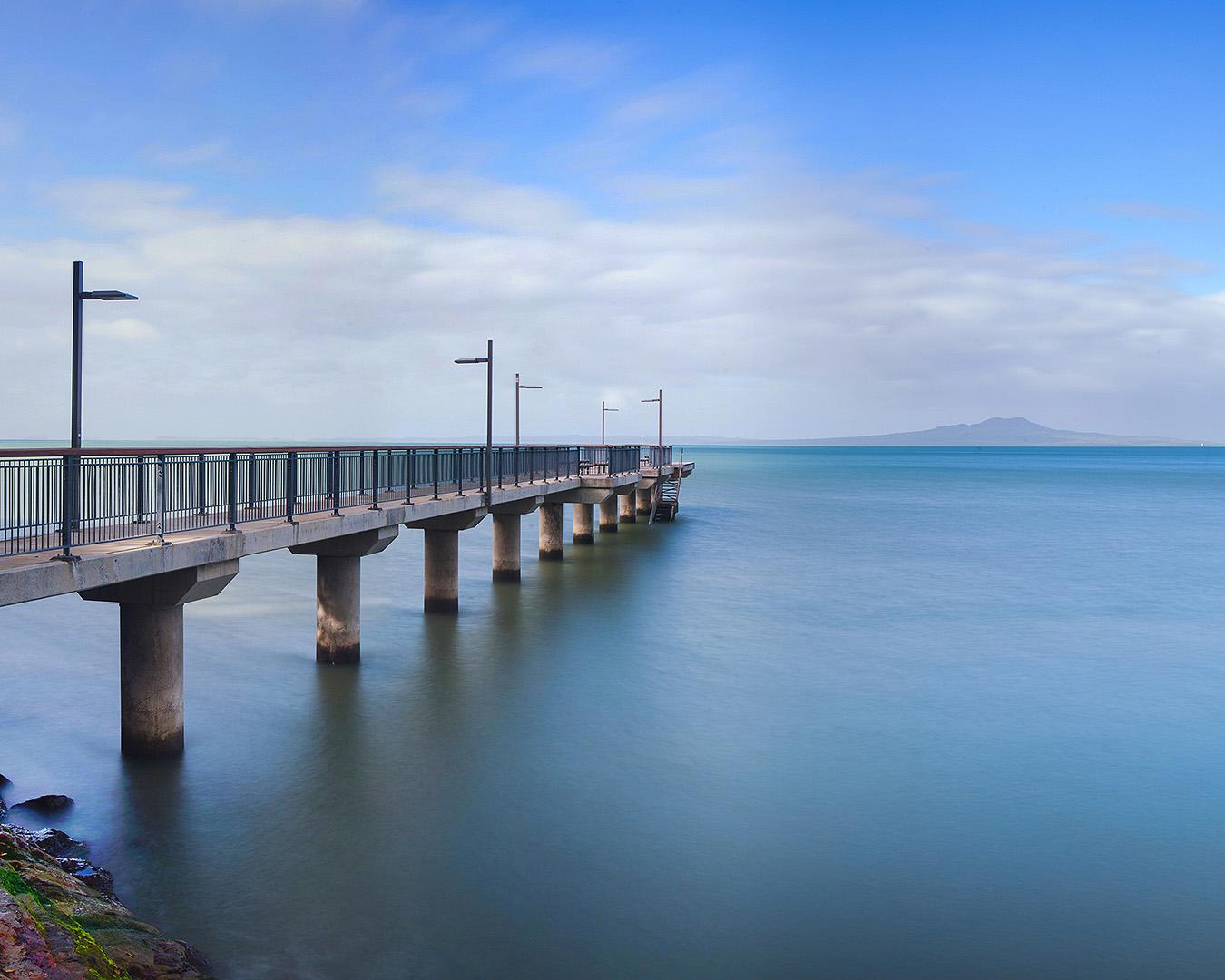 Murrays Bay Wharf extends into the sea.