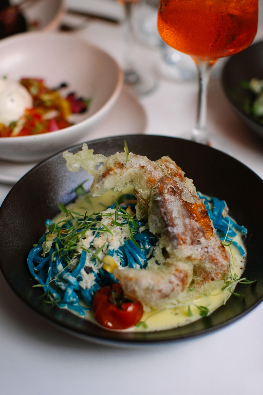 a plate of blue linguine
