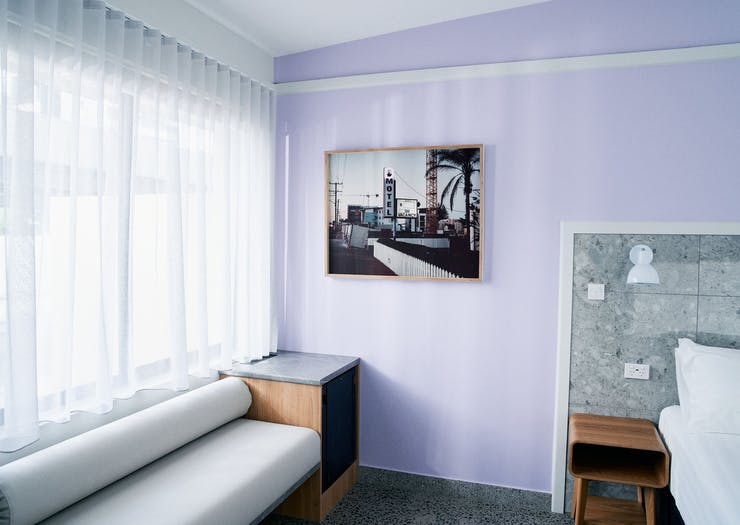 a purple room with a vintage photograph and a vintage couch
