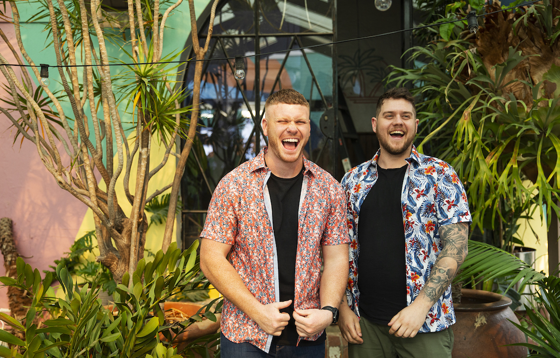 Neon Palm's owners laughing together in new venue