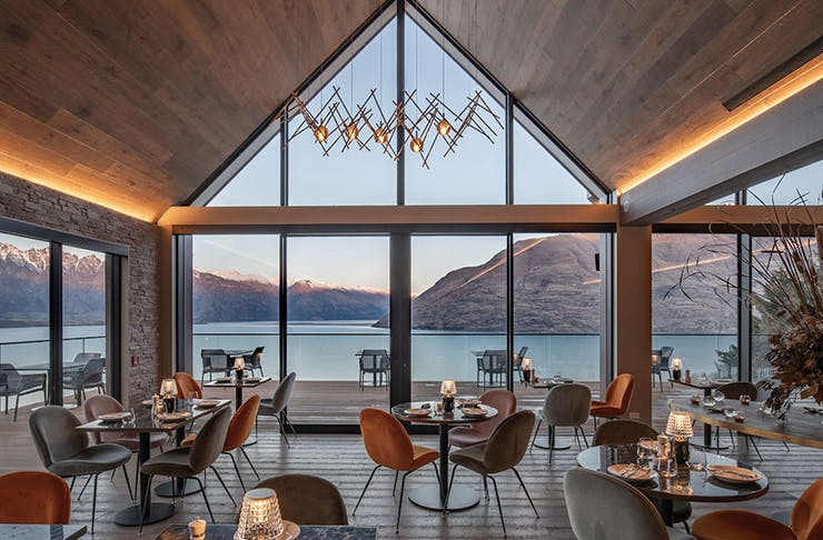 A restaurant overlooking turquoise water in NZ.