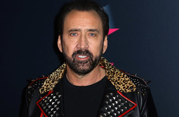 Nicolas Cage in leather jacket lined with faux animal fur.