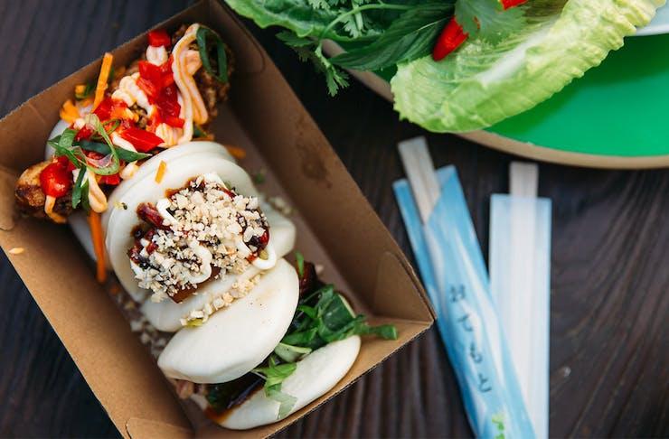 three bao buns in a box