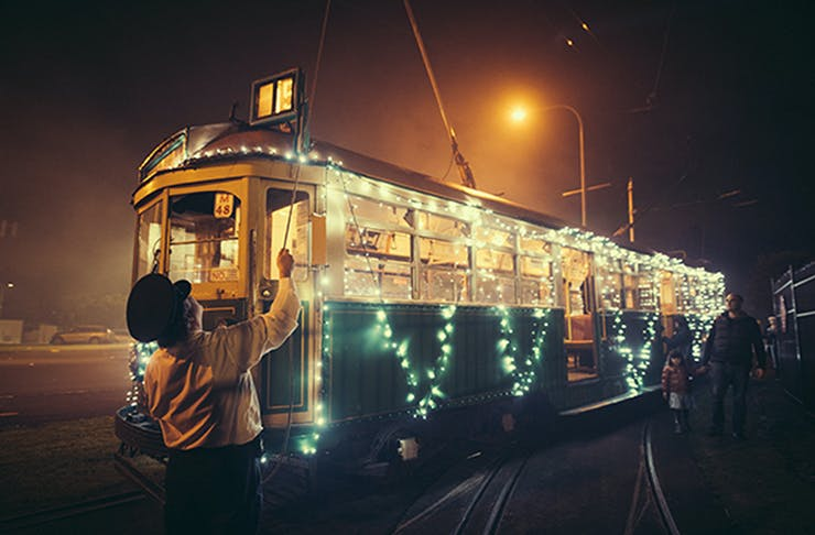 A tram covered in fairy lights.