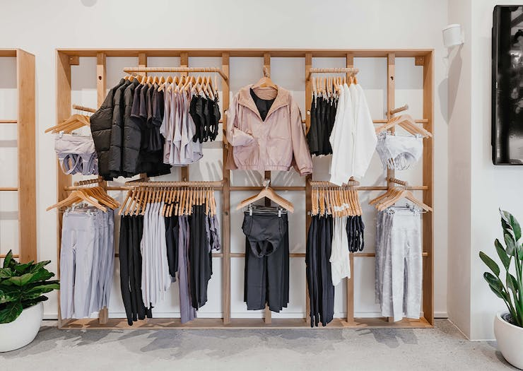 a wall of clothes racks