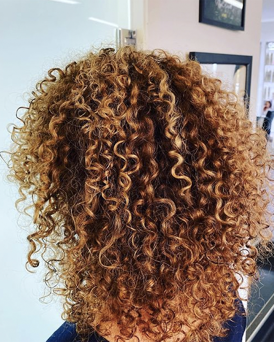 A woman with curly hair.