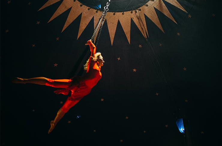 an acrobat in a red suit
