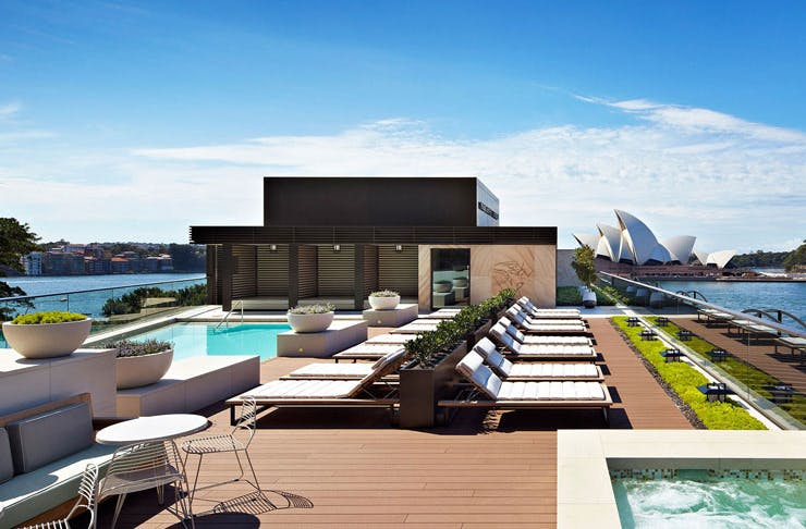 The rooftop pool at the Park Hyatt with Sydney Harbour in the background.