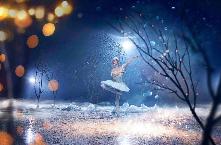 a ballerina on a wintery stage