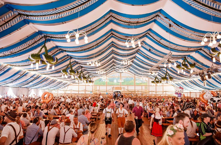 People in a giant tent at the Oktoberfest festival