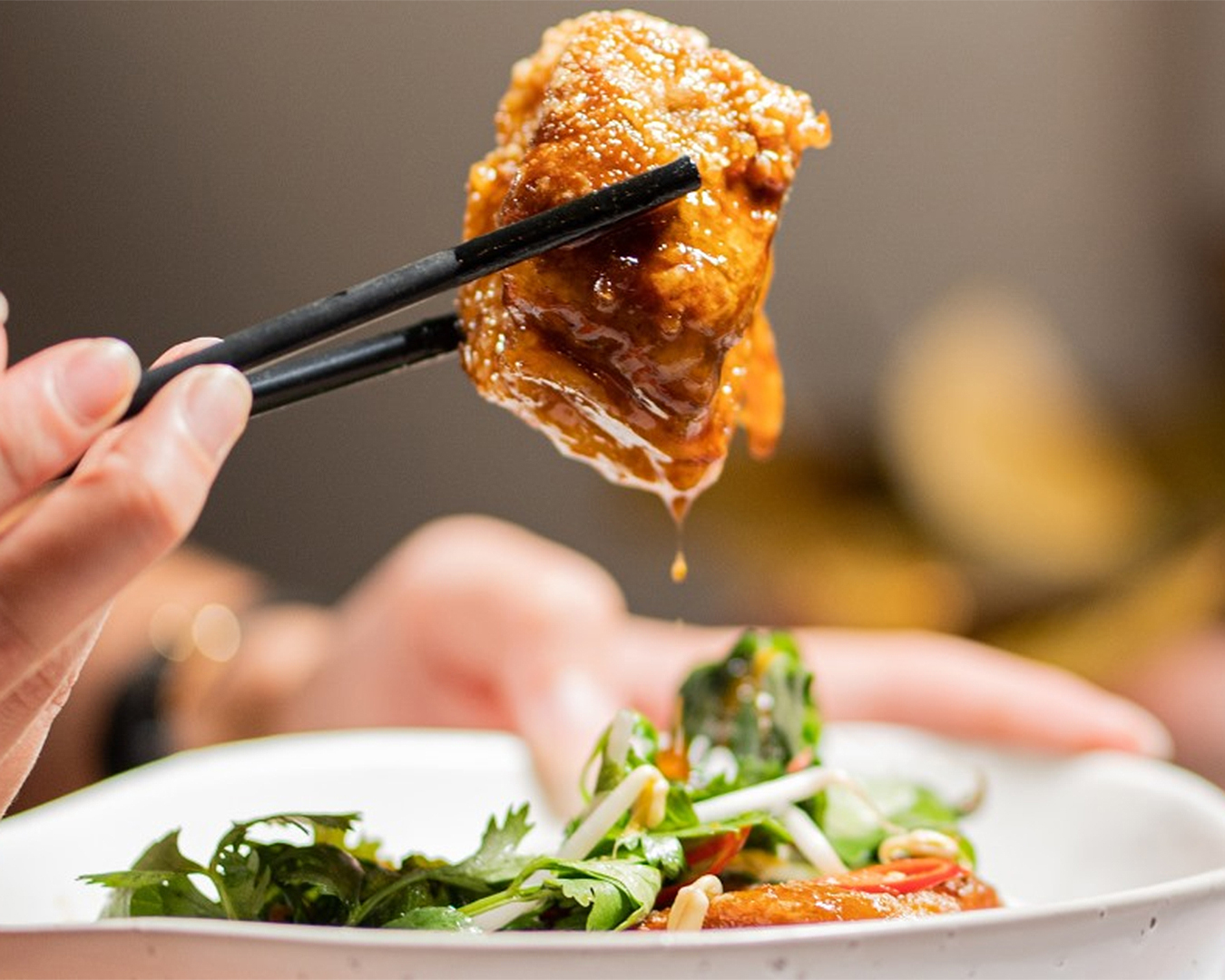 Caramelised pork belly? Paired with fragrant herb salad and crackling dumplings.