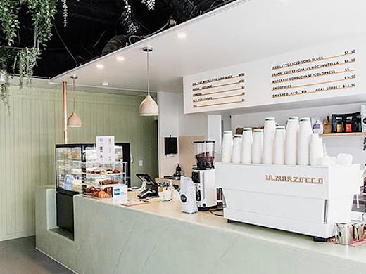 the pastel green interior of a cafe