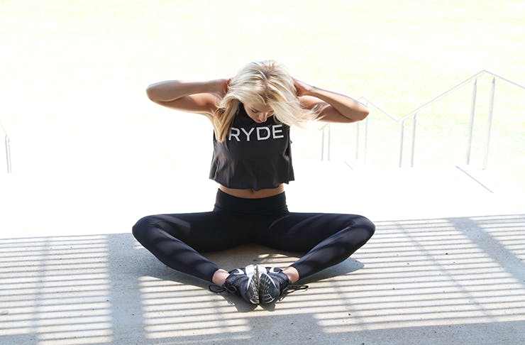 Woman working out at home to one of Melbourne's best virtual fitness sessions