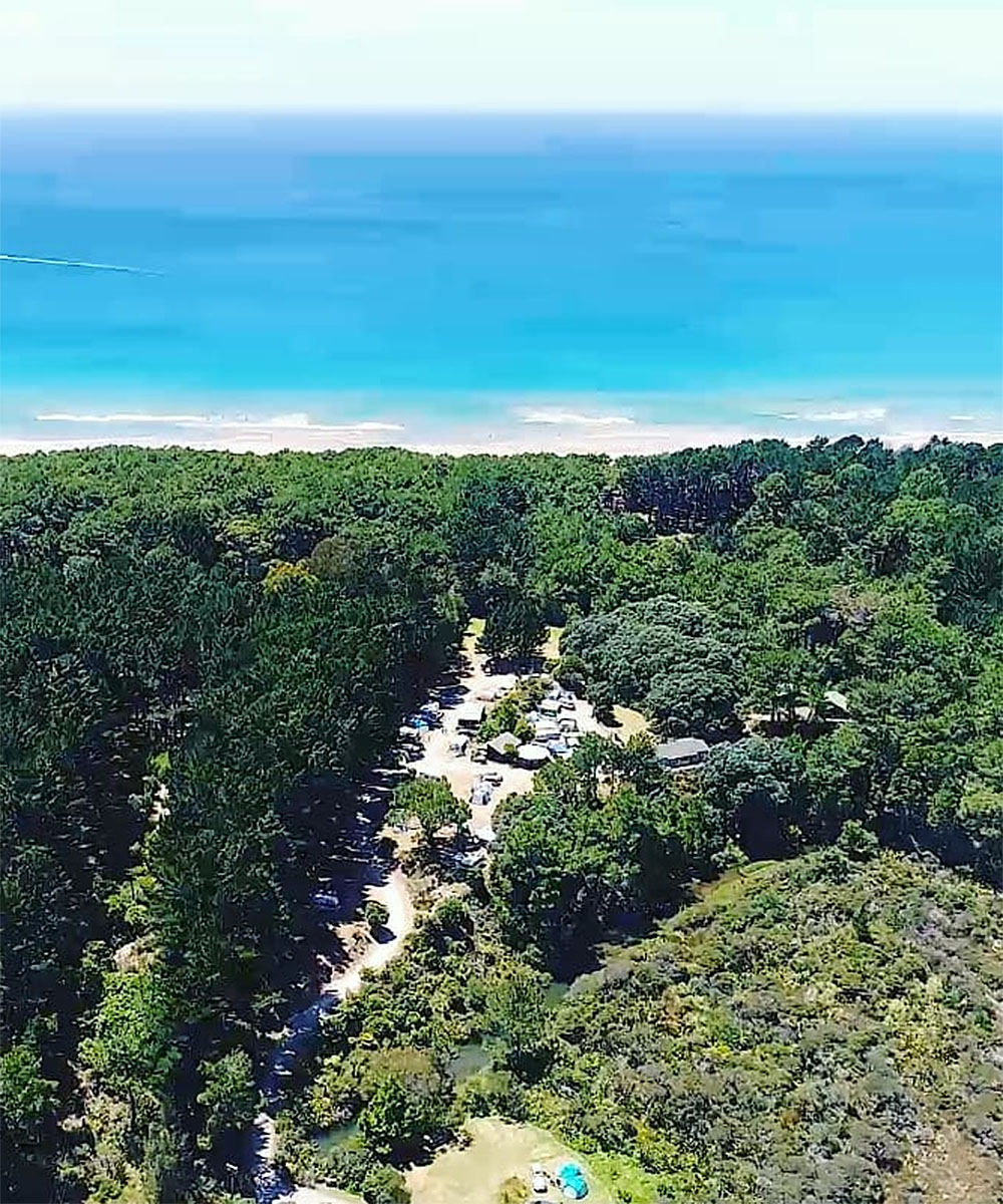An aerial view of Opoutere Coastal campground in the coromandel.
