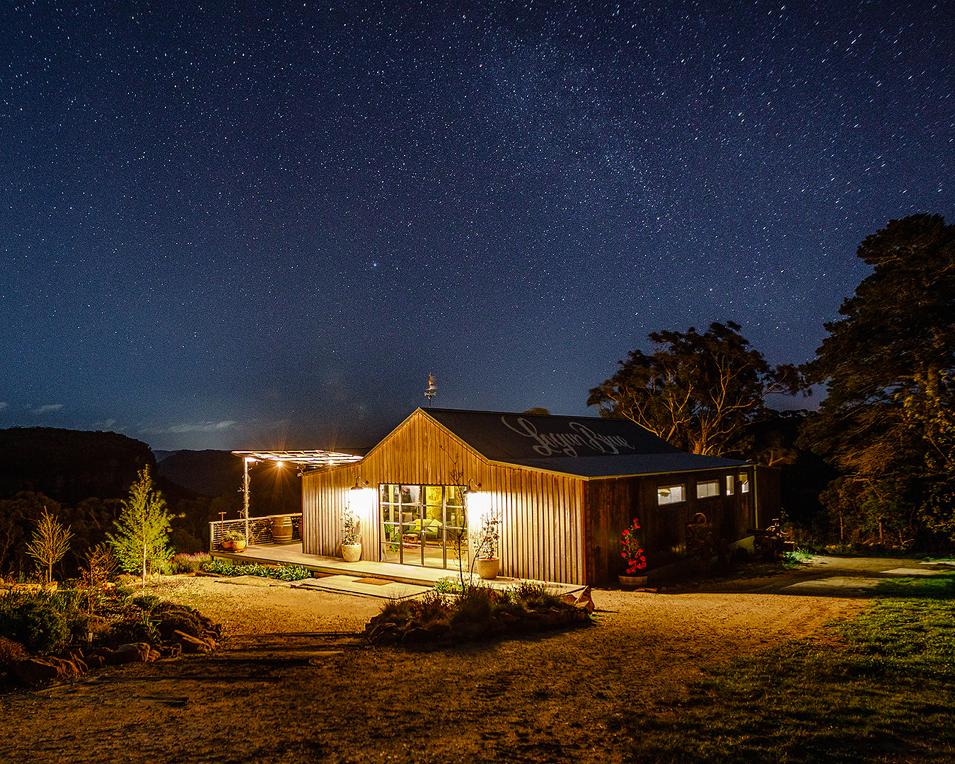 The Orchard Escape under a starry sky.