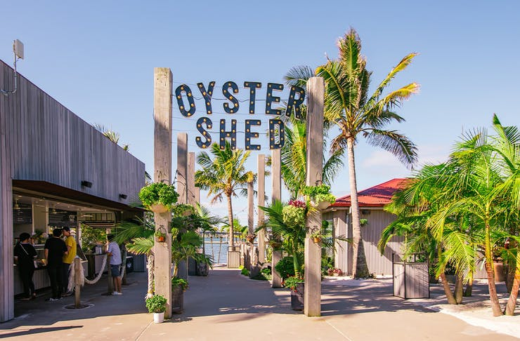 Entrance to the Oyster Shed, with the name in large letters atop a wooden entry way