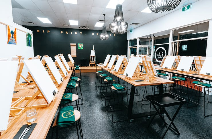 canvases in a paint and sip studio