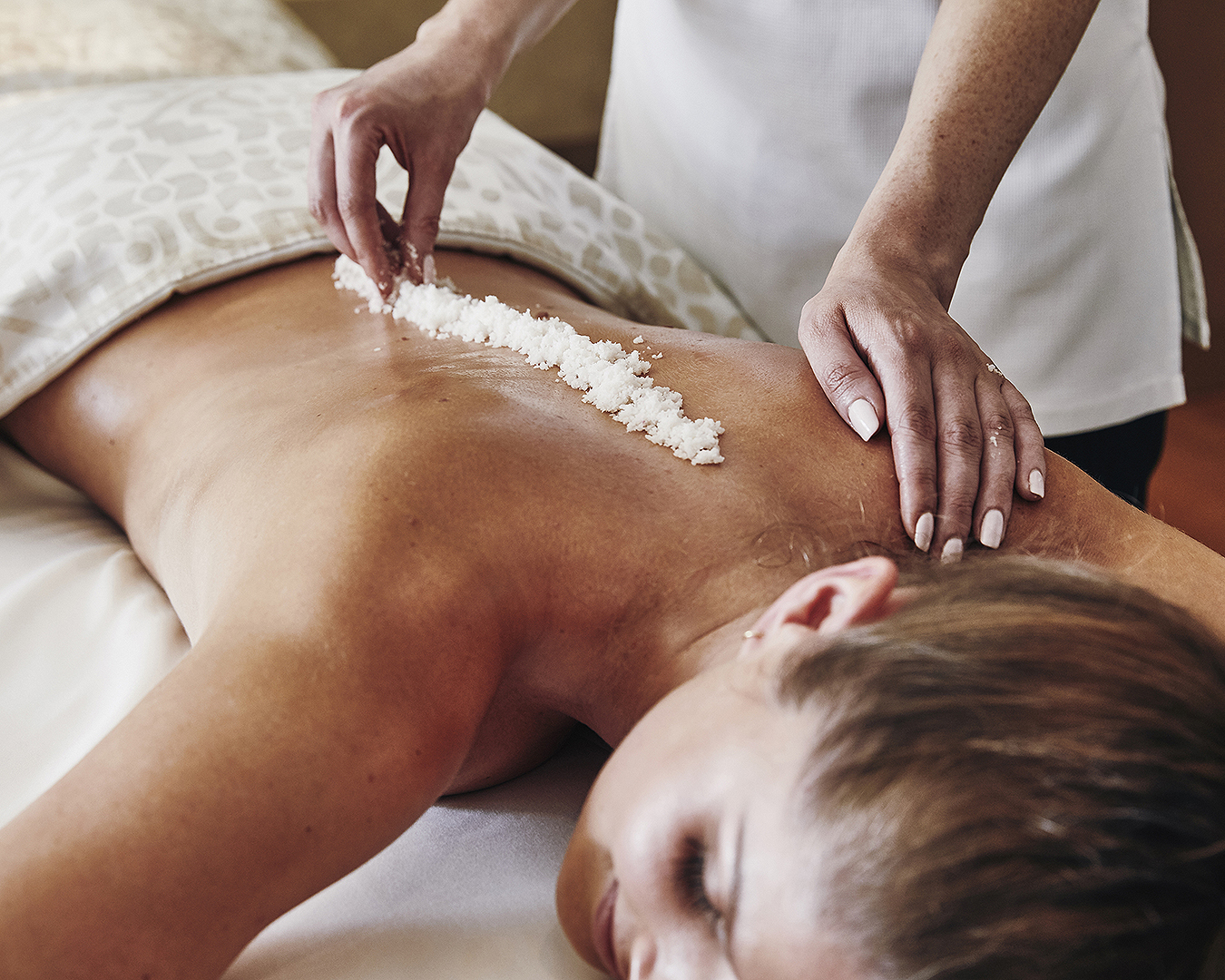 A woman is treated to a lovely spa treatment at the Park Hyatt.