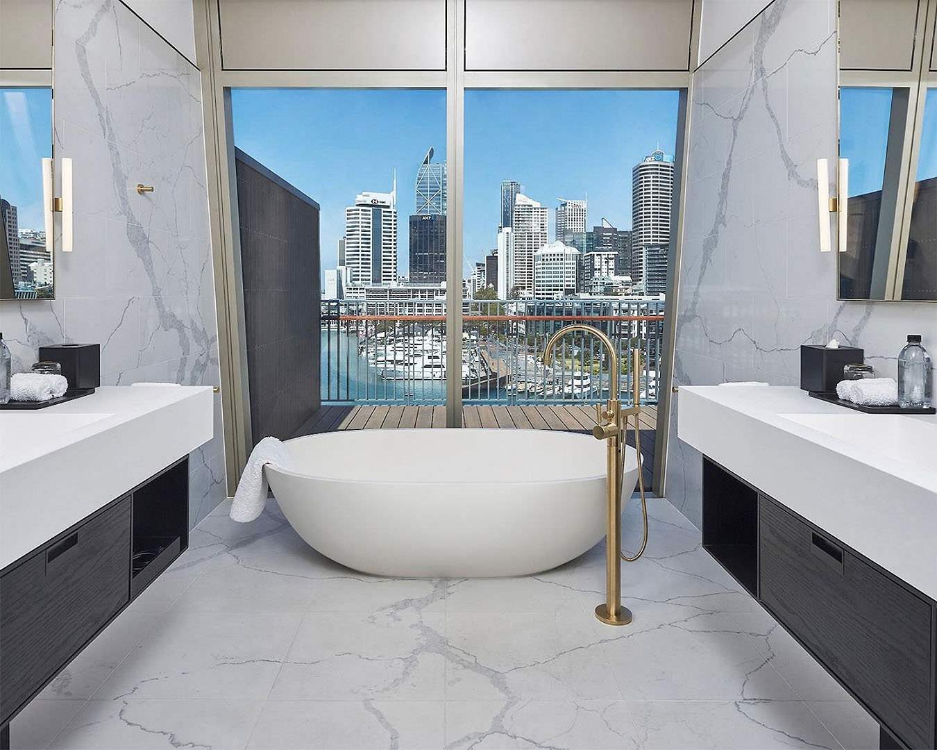 A bath in front of stunning views in a room at The Park Hyatt Auckland.