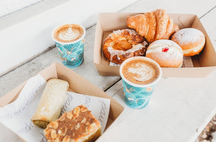 Baked goods in a box with coffee