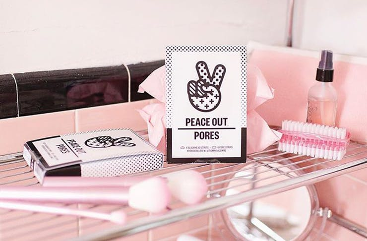 Peace Out products on a shelf with other beauty products.