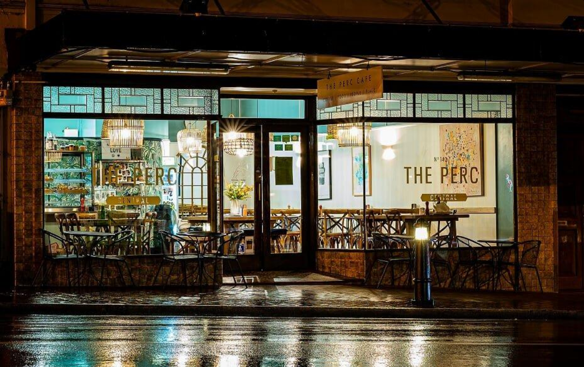 The Perc Cafe shining in moonlight and freshly rained pavement