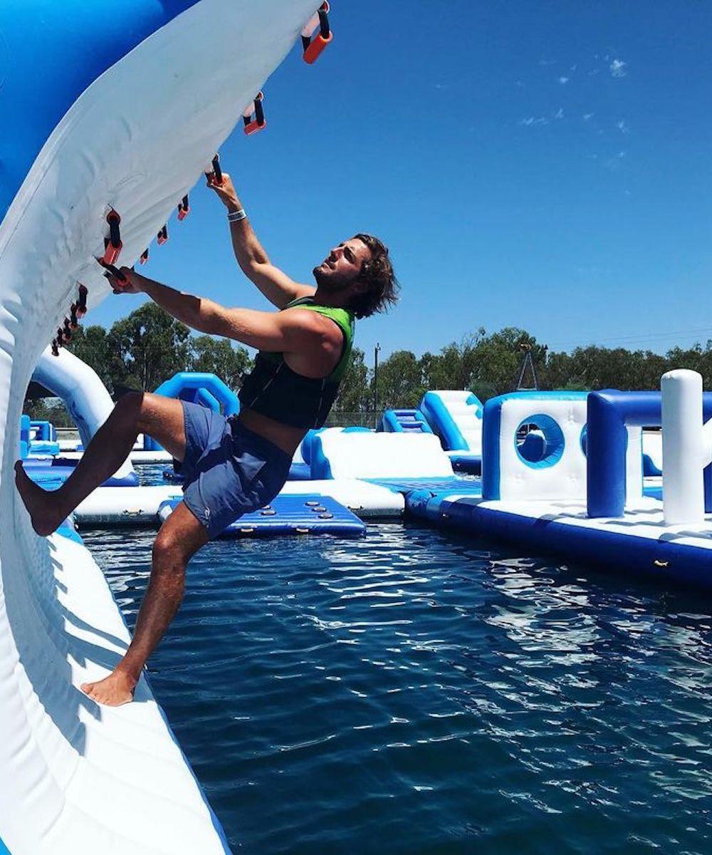 Young guy climbs Perth Aqua Park