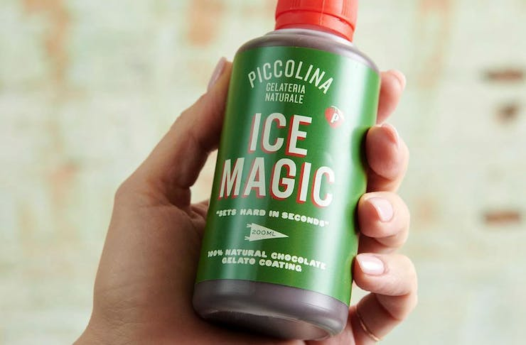 A bottle of Ice Magic being held. Made by Piccolina Gelateria.