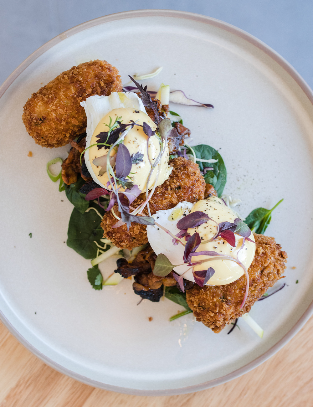 breakfast with croquettes and poached eggs