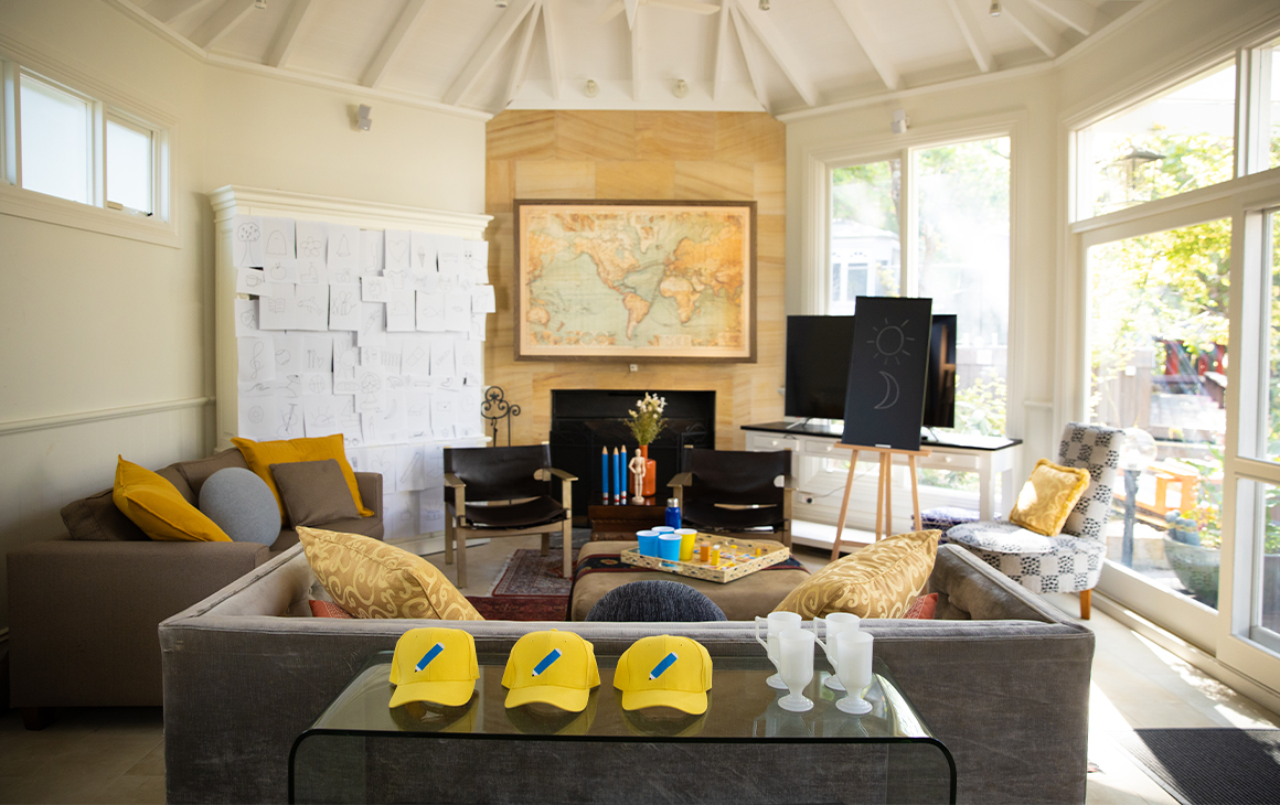 a lounge room with pictionary theming