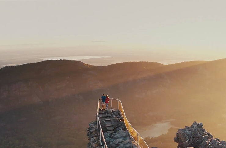 Two hikers at The Pinnacles look-out in The Grampians