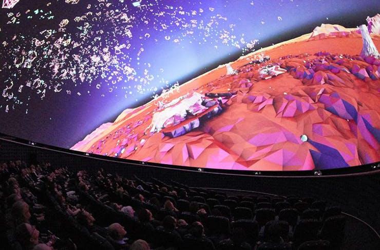 People in a fulldome cinema.
