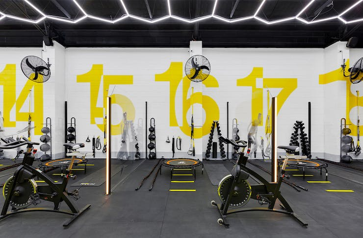 sectioned gym areas filled with exercise equipment