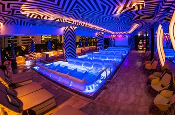 Dive Into This Rooftop Pool Cinema Complete With Floating Cocktail Trays