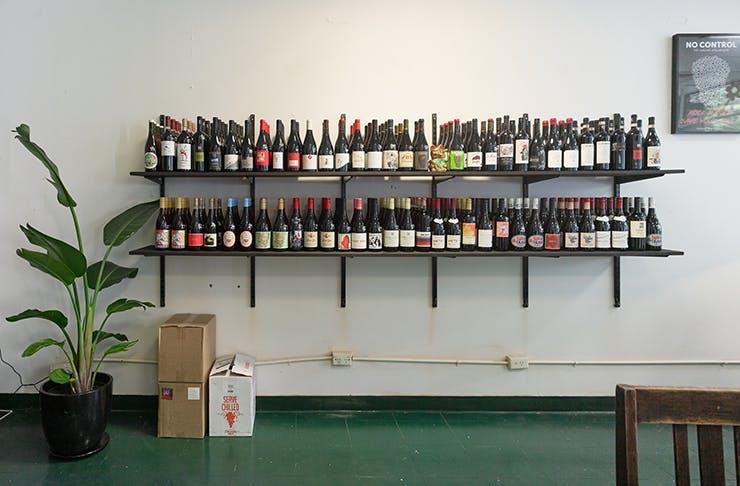 Wine shelf stock up at Punchin' Bottles wine store.