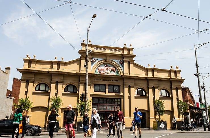 The facade of the Queen Vic Market drenched in sunlight.