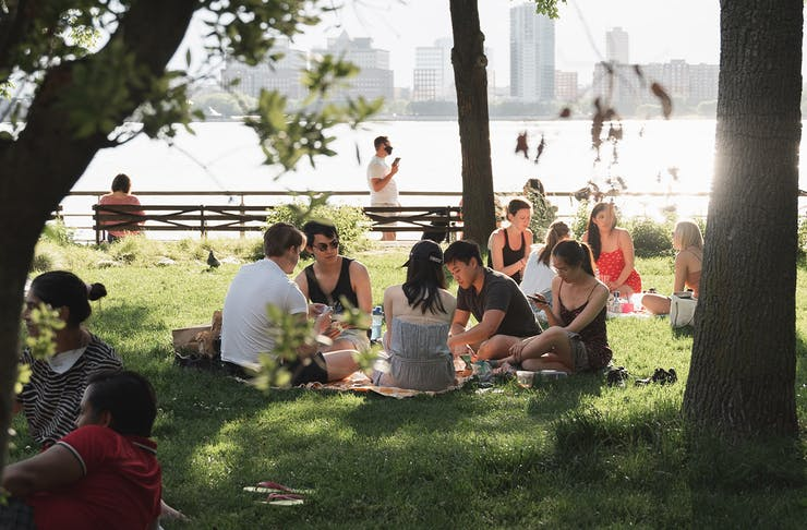 a group of people having a picnic in a park