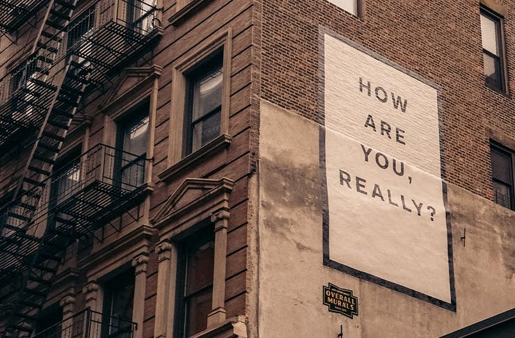 A Poster on a wall that says How Are you, Really?