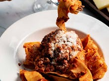 Here's Where You Can Score A Bowl Of Ragu For $9 Or Wine For $1