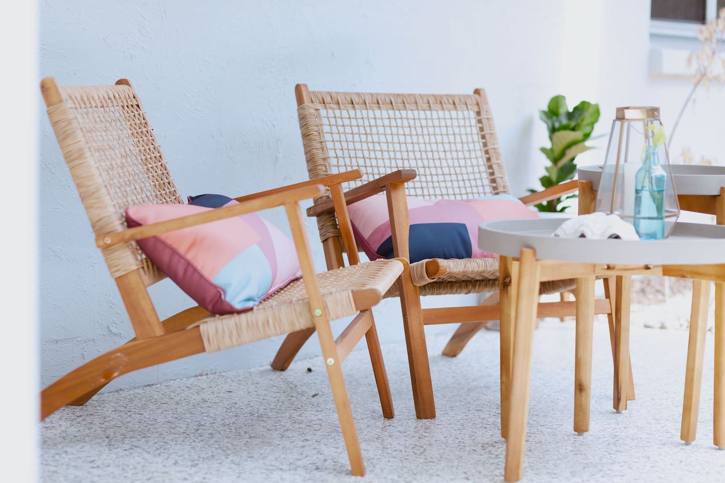 two wooden chairs on a deck