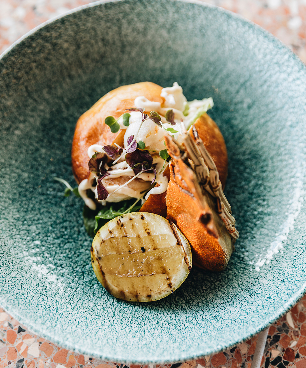a moreton bay bug roll in a bowl