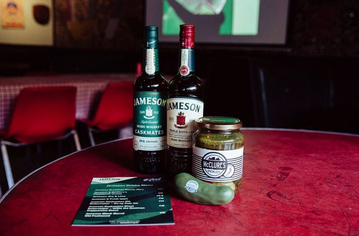Two bottles of Jameson whisky with a jar of pickles at The Oxford Tavern in Petersham, Sydney.