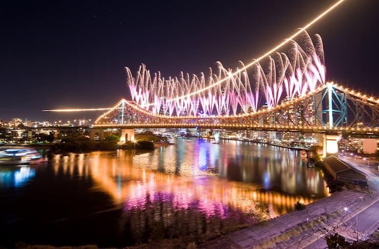 fireworks over a bridge