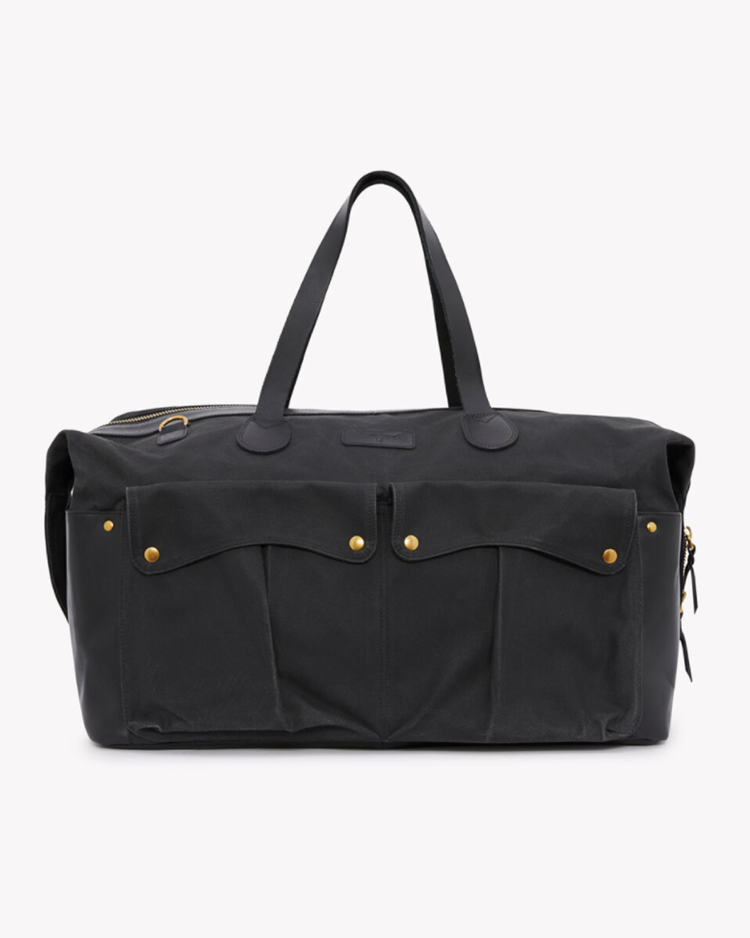 A masculine black canvas duffle bag with leather handles and gold accents
