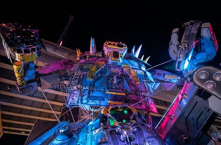 A large robot installation towering up into the night sky.